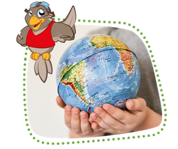 A globe in the hands of a child