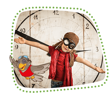 Lexi flies past a large wall clock in front of which a child in a flying outfit is standing